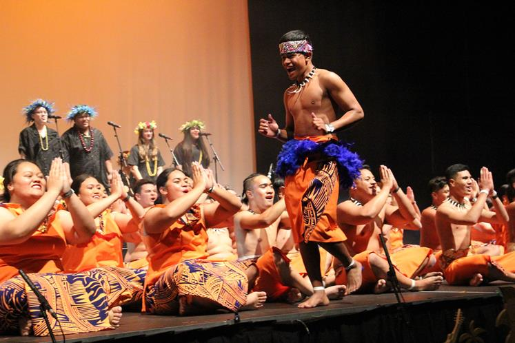 Norman Tofilau revs up the crowd and the performers in Pasifika by Nature at Fraser High School