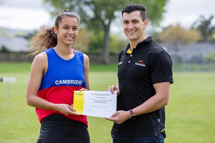 Winning athlete, Hinewai Knowles receives her  Champion of the Codes award from Wintec academic, Jako Bekker.