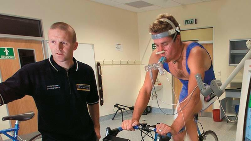 Sport scientist measuring athlete performance