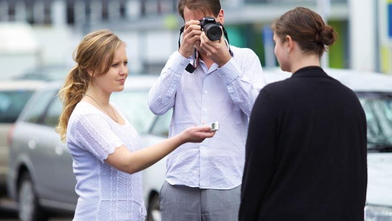 Journalist and photography interviewing subject