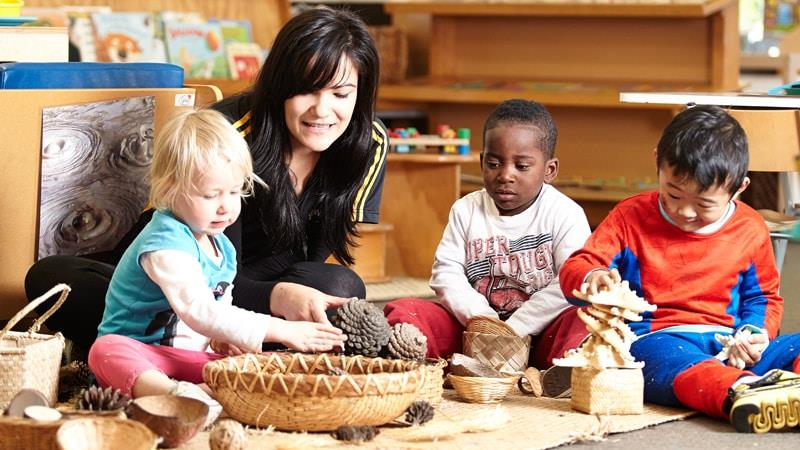 Early Childhood Education teacher working with children in a centre