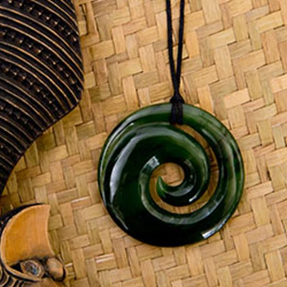 close up of Maori koru with flax
