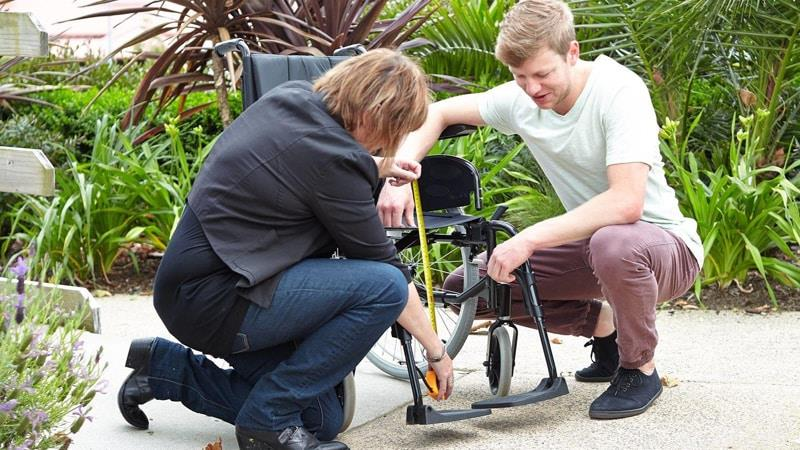 Occupational therapists measuring wheelchair