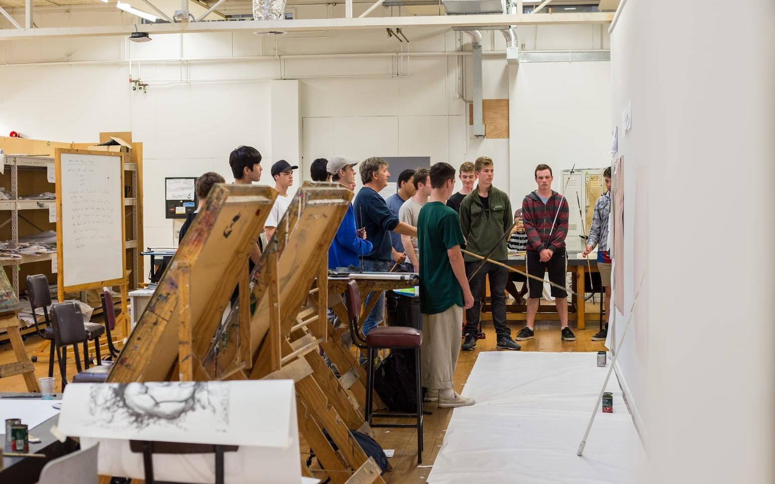 Secondary School students taking part in arts exercise in studio