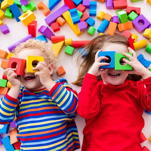 toddlers playing with coloured blocks