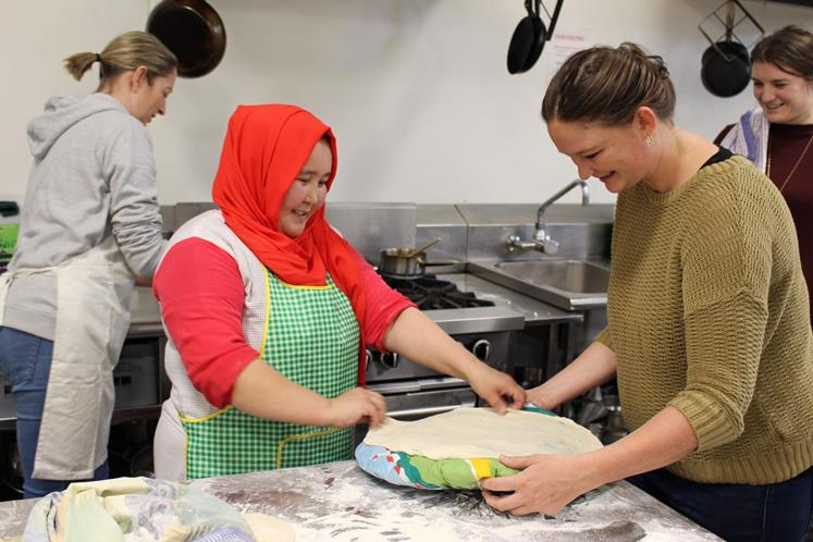 Chef Taj Hussaini demonstrates naan during a Home Kitchen cooking class at Wintec