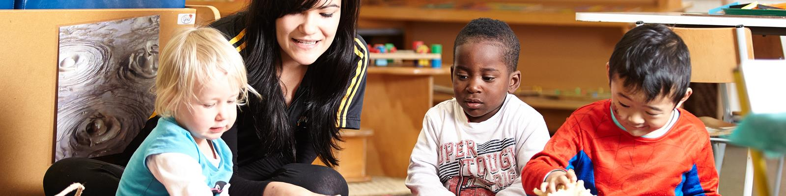 early childhood education educator teaching young children in a centre