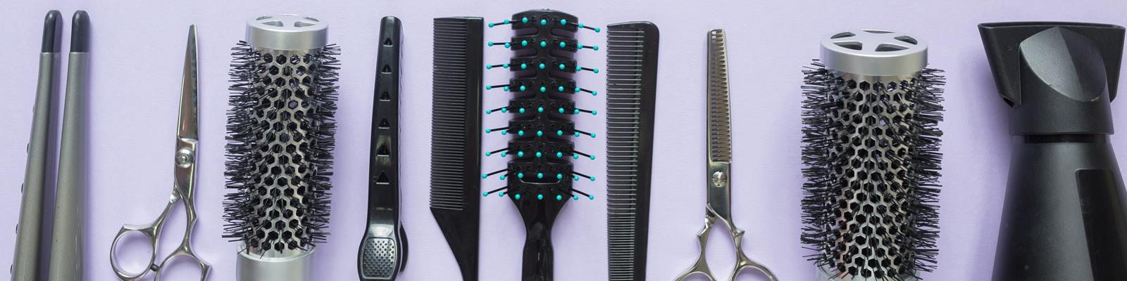 hairdressers tools - scissors, brush, comb, straighteners, hair dryer