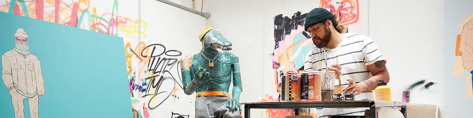 Contemporary art student working in studio