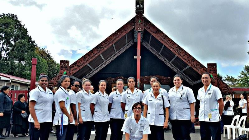 Nursing students standing outside marae