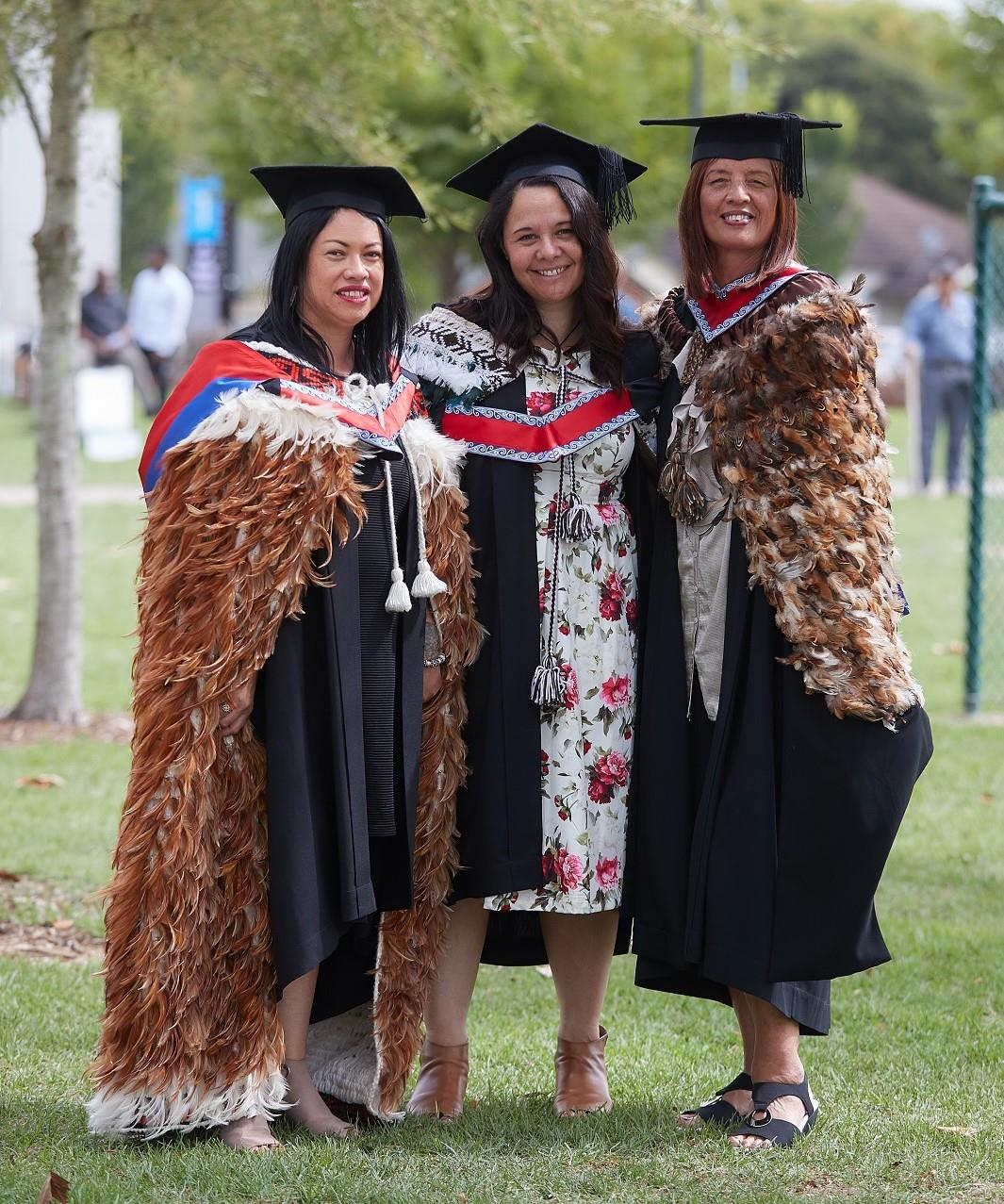 Wintec Māori Masters graduates Natalie Lewis, Janette Ngaheu and Myra Pourau at their graduation.
