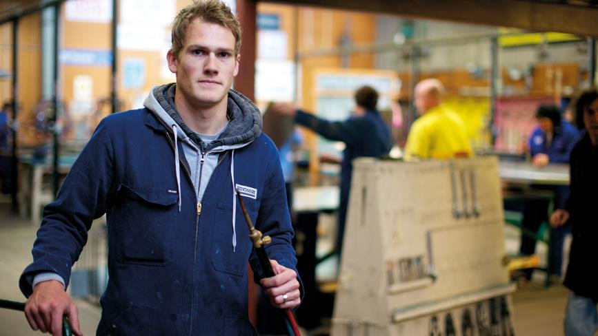 Trades student standing in workshop