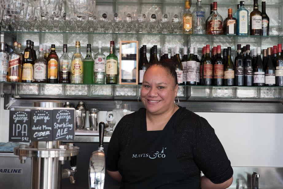 Wintec hospitality graduate Shinnel Uerata standing behind a bar