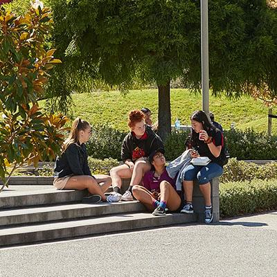 Students seated outside Rotokauri Campus hub