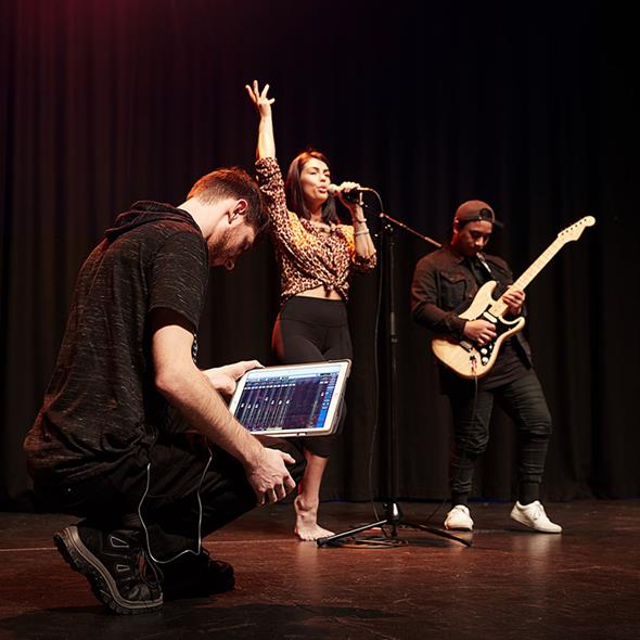 Music and performing arts students on stage
