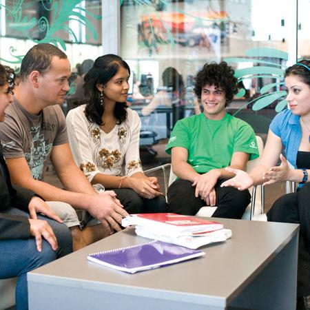 International students talking in the hub