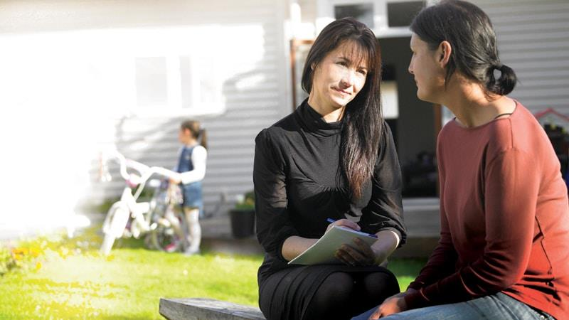 Social worker talking to client