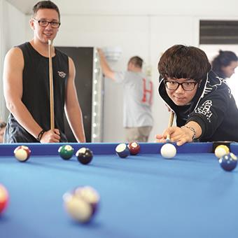 students playing pool in student accommodation