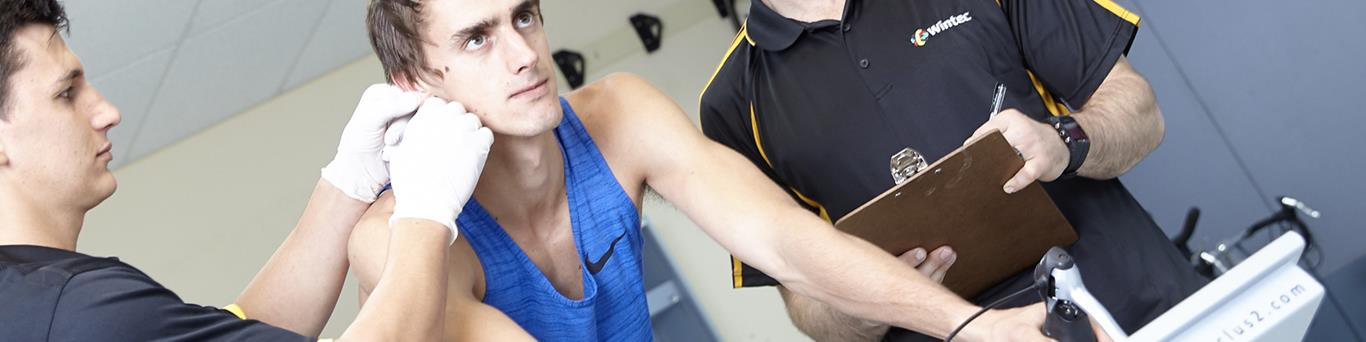 sport scientists measuring output of athlete