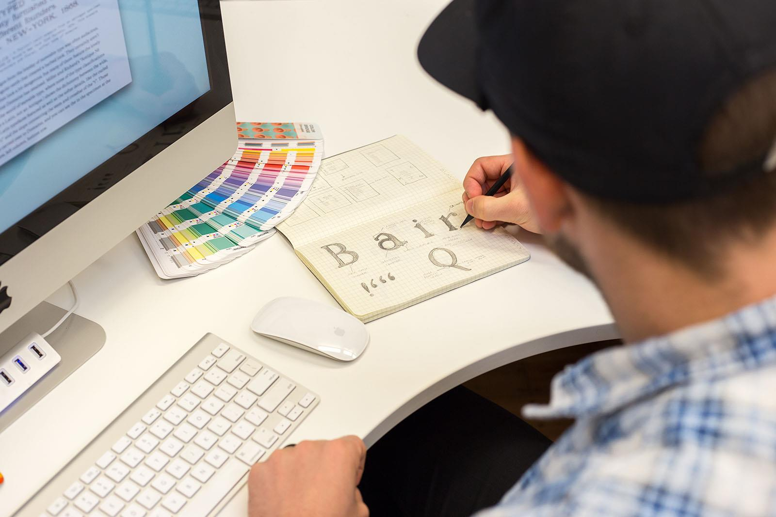Design student drawing fonts