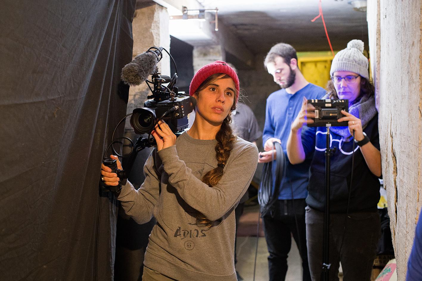 Director of photography, Sara Guix and Wintec Alumni David Tharratt (camera assist) prepare to reposition the camera in Blink.