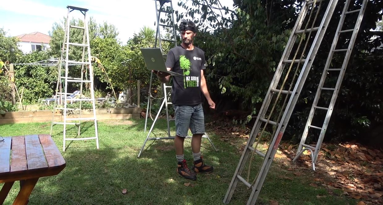 Andrew Harrison taking a virtual class in his garden
