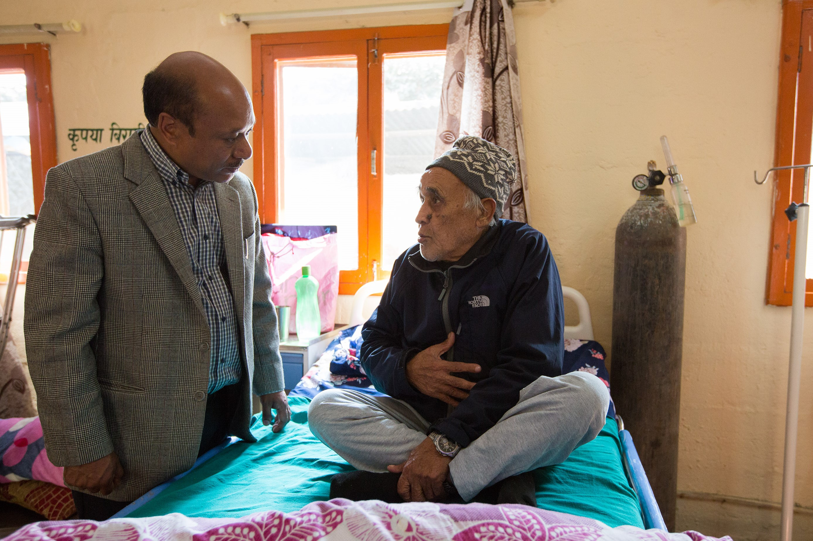 Professor Rajesh Gongol and patient at Hospice Nepal. Image supplied by the Hospice Nepal Project.