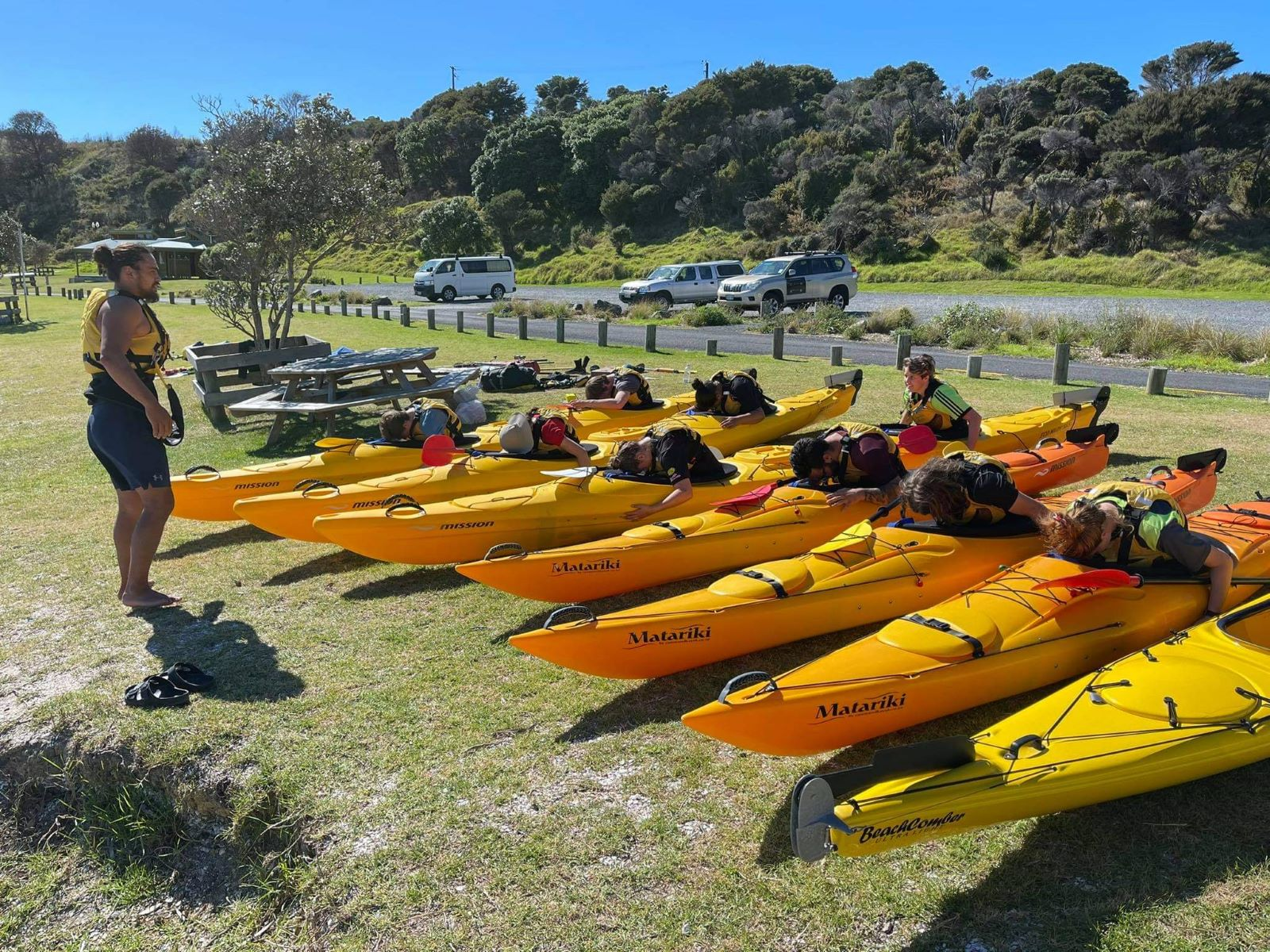 Students learn what to do if they flip upside down before a sea kayaking session