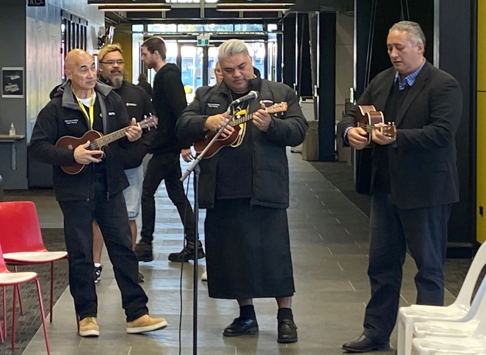 Wintec staff playing ukulele at the Rotokauri campus pōwhiri to welcome students